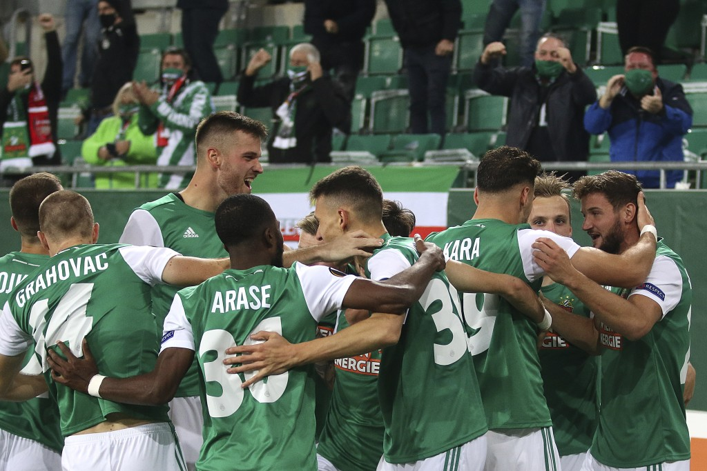 Rapid Wien players celebrates a goal against Arsenal during the Europa League group B soccer match between SK Rapid Wien and FC Arsenal at the Alianz ...