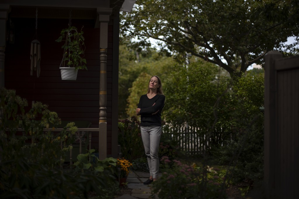 Charlotte Breed Handy, 57, a direct descendant of a Pilgrim who came over on the Mayflower, stands for a portrait outside her home in Providence, R.I....