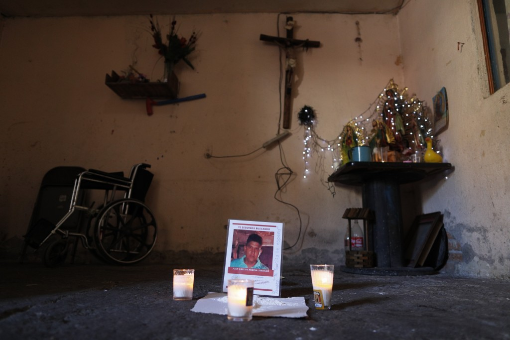 FILE - This Feb. 13, 2020 file photo shows a memorial for Juan Carlos Medina Serrano in his family's living room, the day his remains were buried, in ...
