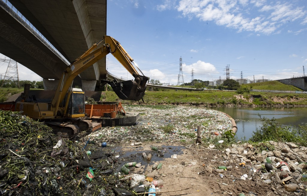 An excavator removes debris from the banks of the Pinheiros River in Sao Paulo, Brazil, Thursday, Oct. 22, 2020. Affected by domestic sewage and solid...