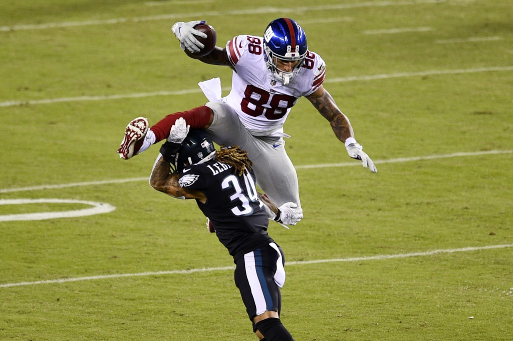 New York Giants' Evan Engram (88) tries to leap over Philadelphia Eagles' Cre'Von LeBlanc (34) during the second half of an NFL football game, Thursda...