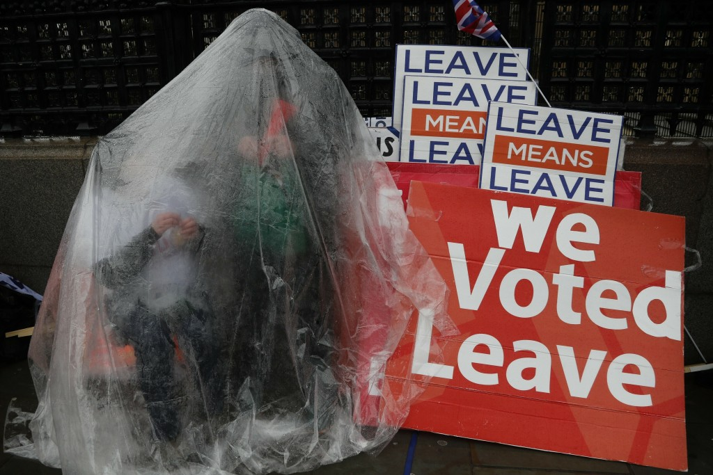 FILE - In this Tuesday, March 12, 2019 file photo a Pro-Brexit leave the European Union supporter takes part in a protest outside the Houses of Parlia...