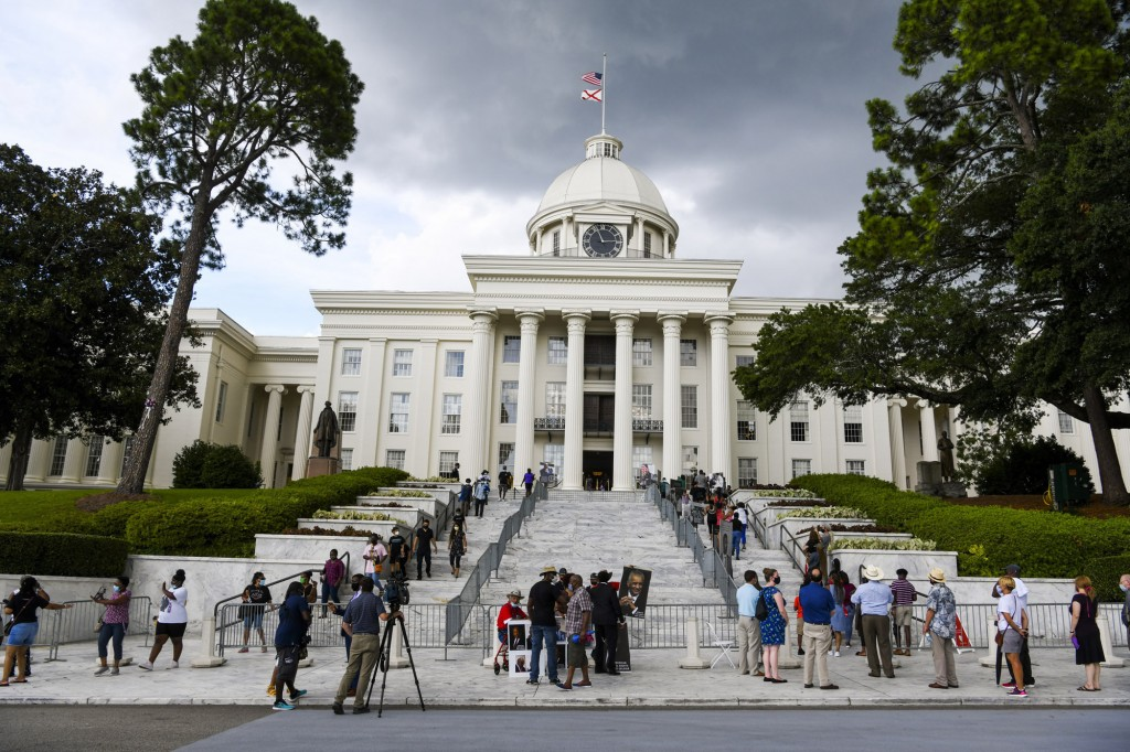FILE - In this July 26, 2020, file photo,  mourners gathered at the Alabama Capitol following the death of Rep. John Lewis. Alabama voters will decide...