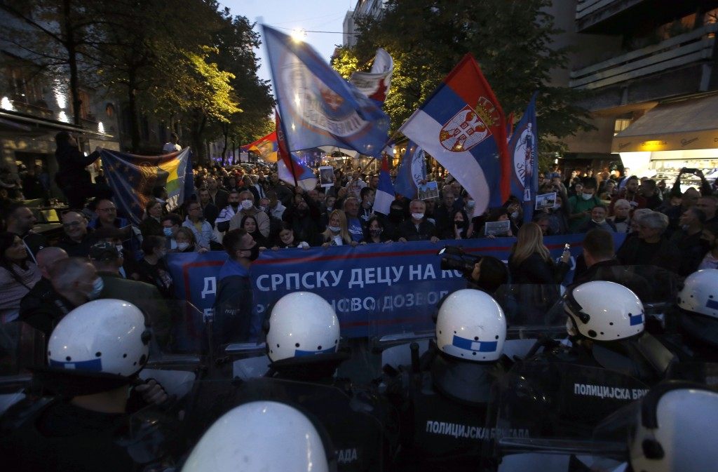 Serbian police officers guard the street during a protest against a festival ''Mirdita-Dobar Dan'' organized by liberal groups from Serbia and Kosovo,...