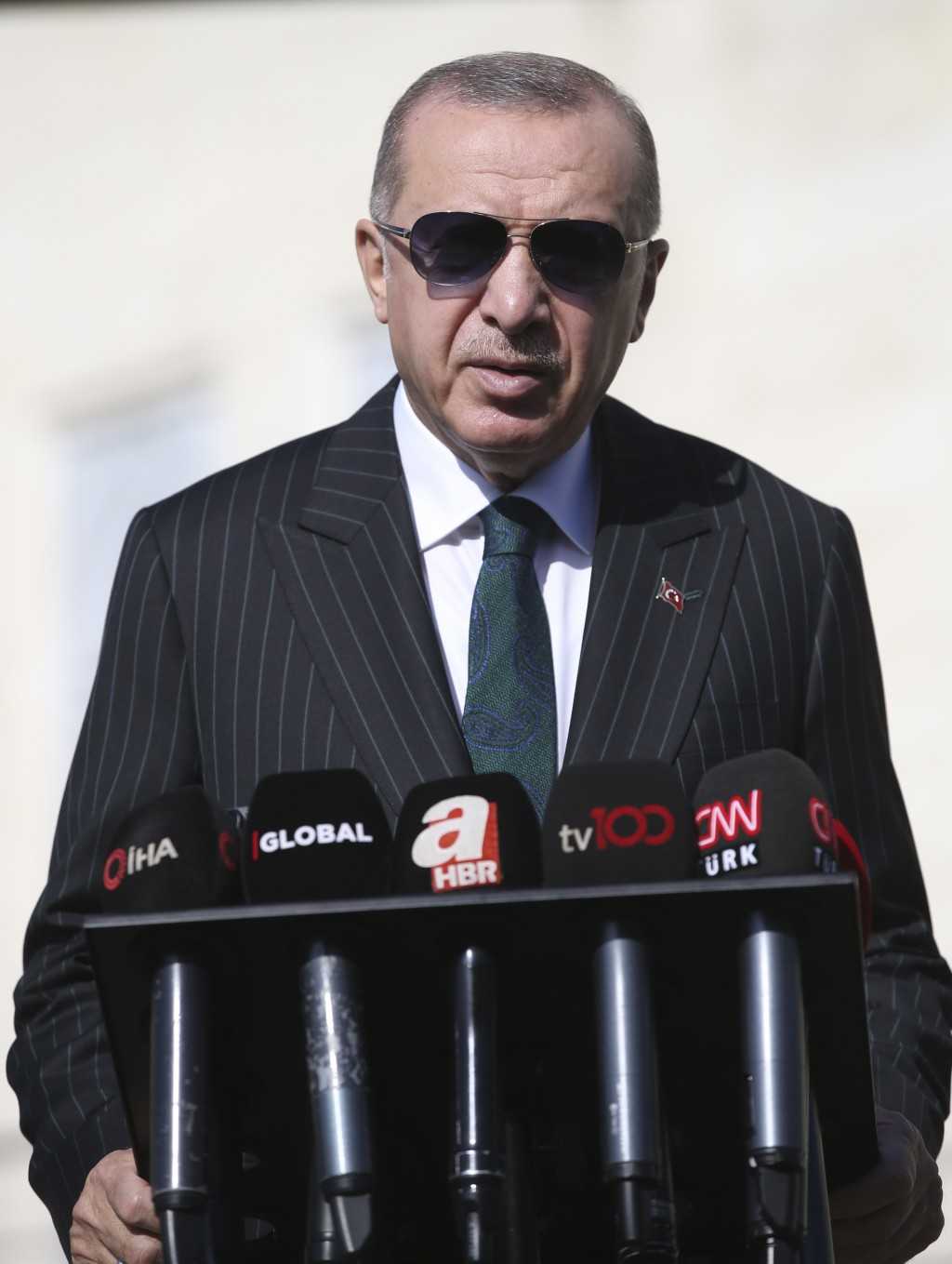 Turkey's President Recep Tayyip Erdogan speaks to the media, in Istanbul, Friday, Oct. 23, 2020. Erdogan confirmed the country tested its Russian-made...