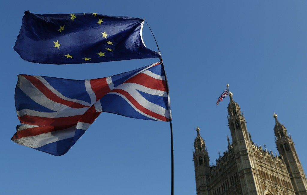 FILE - In this Wednesday, Feb. 27, 2019 file photo the flag of the European Union and the British national flag are flown on poles during a demonstrat...