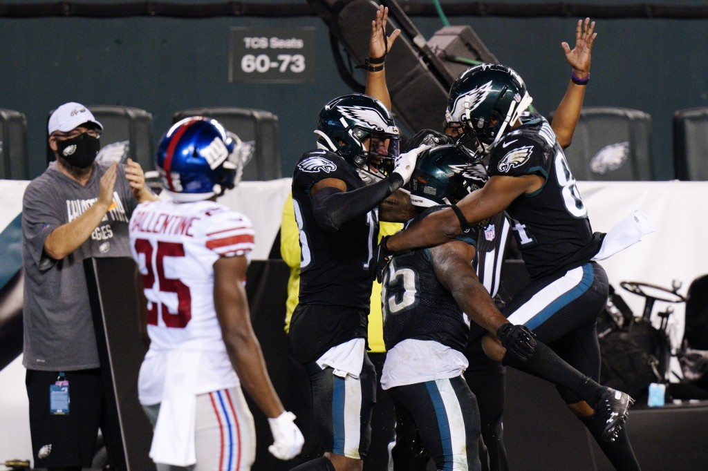 Philadelphia Eagles players celebrate after a touchdown by Boston Scott during the second half of an NFL football game against the New York Giants, Th...