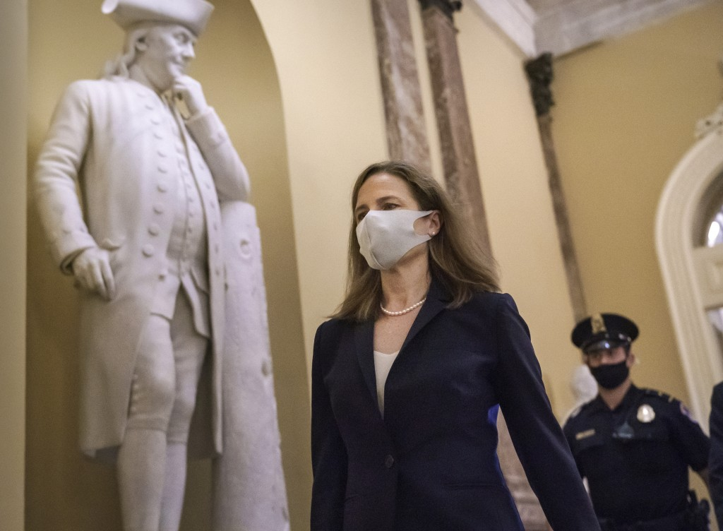 Judge Amy Coney Barrett, President Donald Trump's nominee for the Supreme Court, arrives for closed meetings with senators, at the Capitol in Washingt...