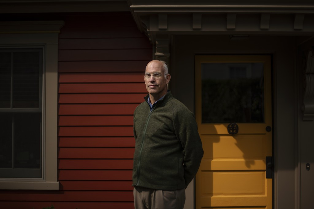 Seth Handy, 53, a direct descendant of a Pilgrim who came over on the Mayflower, stands for a portrait outside his home in Providence, R.I., Tuesday, ...