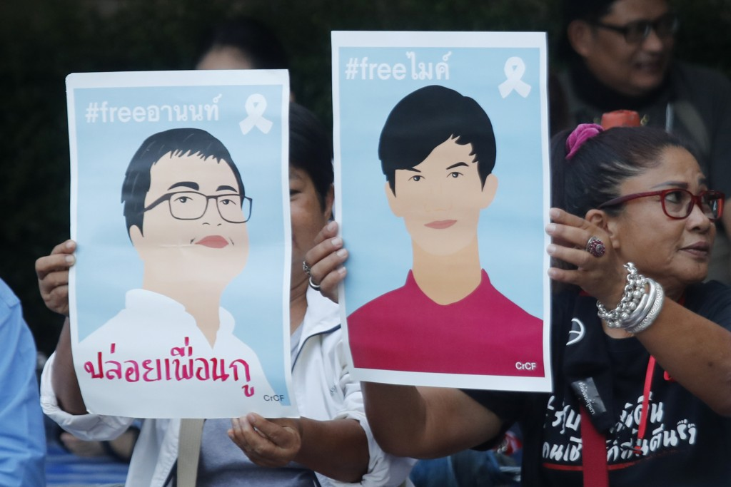 Pro-democracy activists display images of protest leaders that are kept in detention during a protest outside remand prison, in which some of the acti...