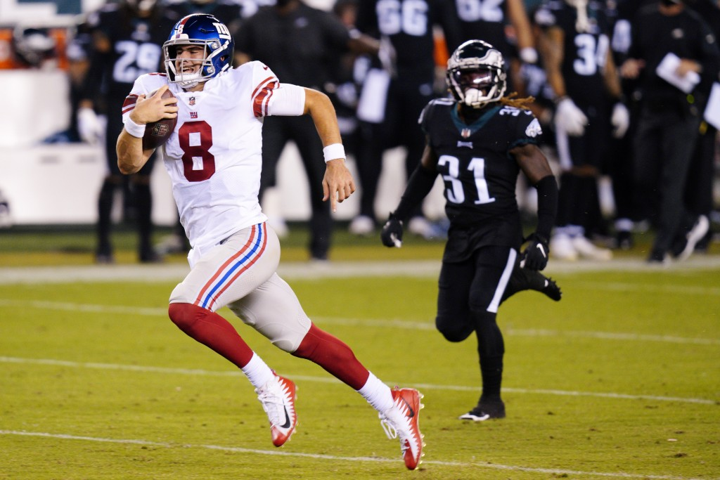 New York Giants' Daniel Jones runs with the ball during the second half of an NFL football game against the Philadelphia Eagles, Thursday, Oct. 22, 20...