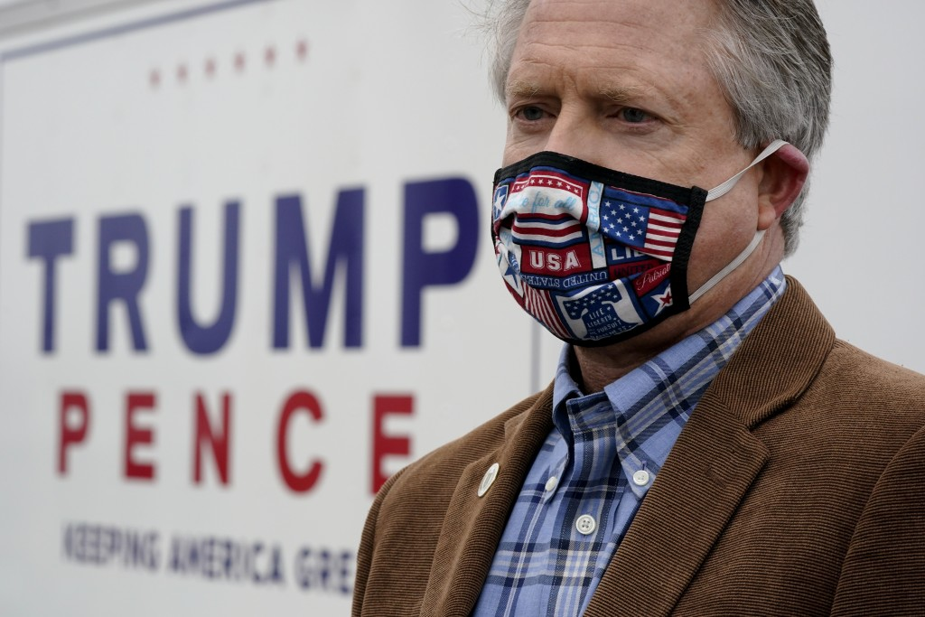 U.S. Rep. Roger Marshall, R-Kan., wearing a mask, talks to the media while attending a Concerned Women for America event outside a gun store in Kansas...