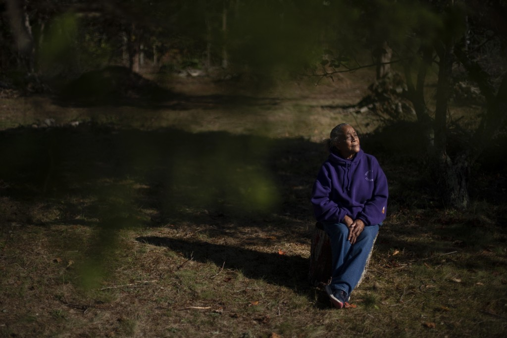 """Hazel Harding Currence, 78, a Herring Pond Wampanoag Tribe Elder, sits for a portrait in her backyard in Bourne, Mass., Tuesday, Oct. 6, 2020. """"We wer..."""