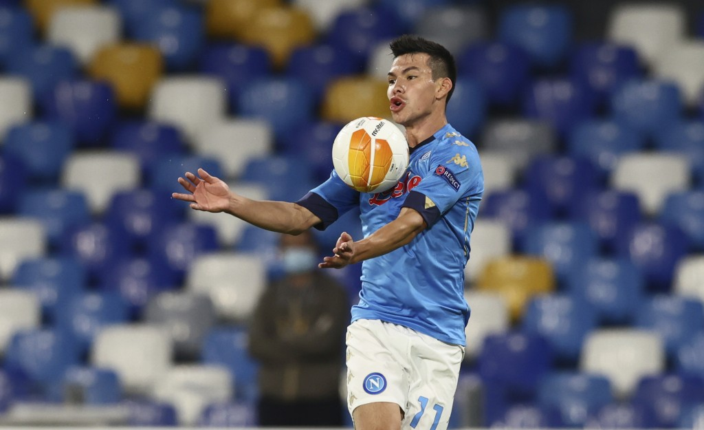 Napoli's Hirving Lozano stops the ball during the Europa League, group F soccer match between Napoli and AZ Alkmaar, at the San Paolo Stadium in Naple...