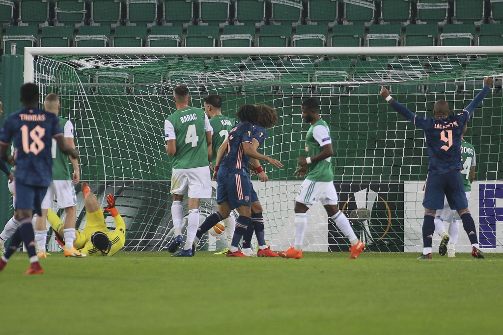 Arsenal's David Luiz scores against Rapid Wien during the Europa League group B soccer match between SK Rapid Wien and FC Arsenal at the Alianz Stadiu...