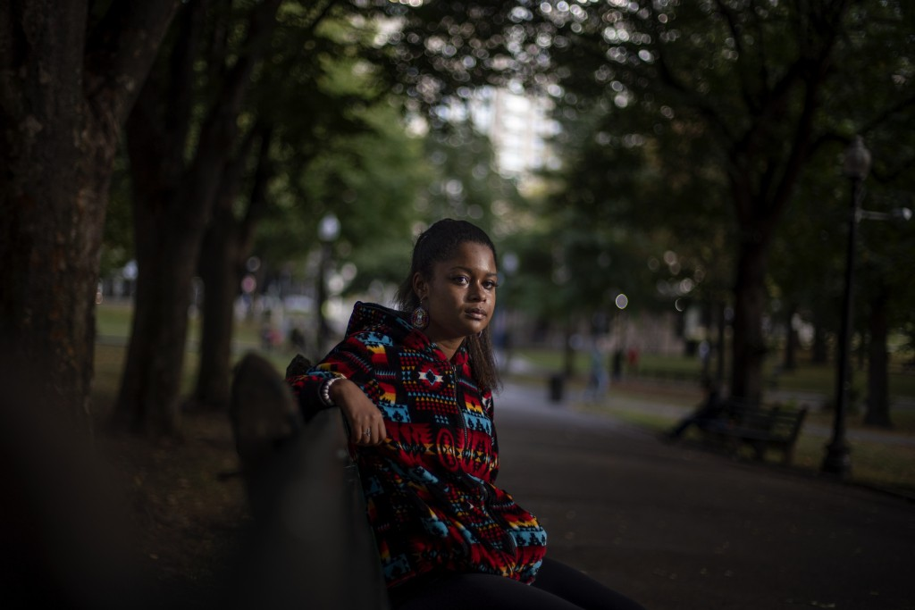 """Alyssa Harris, 18, a member of the Mashpee Wampanoag Tribe, sits for a portrait in a park in Boston, Friday, Oct. 2, 2020. """"I just feel like this is t..."""