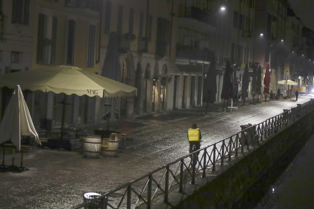 Pubs and bars are closed at the Navigli area, a popular evening spot of restaurants and pubs bordering canals in Milan, Italy, Thursday, Oct. 22, 2020...