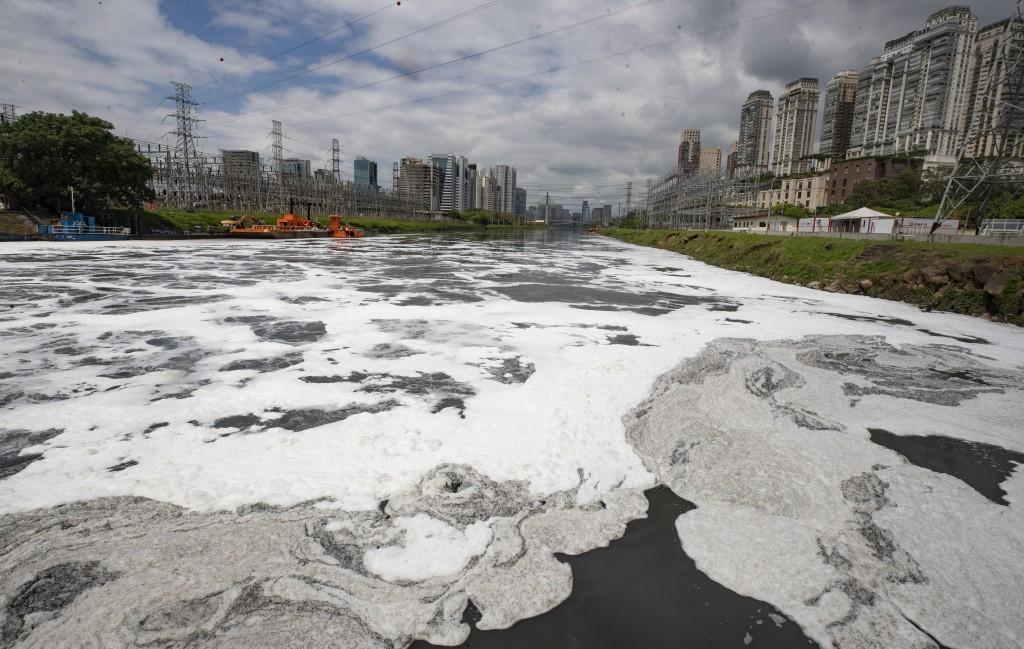 Foam blankets a portion of the Pinheiros River in Sao Paulo, Brazil, Thursday, Oct. 22, 2020. Affected by domestic sewage and solid wastes discharges ...