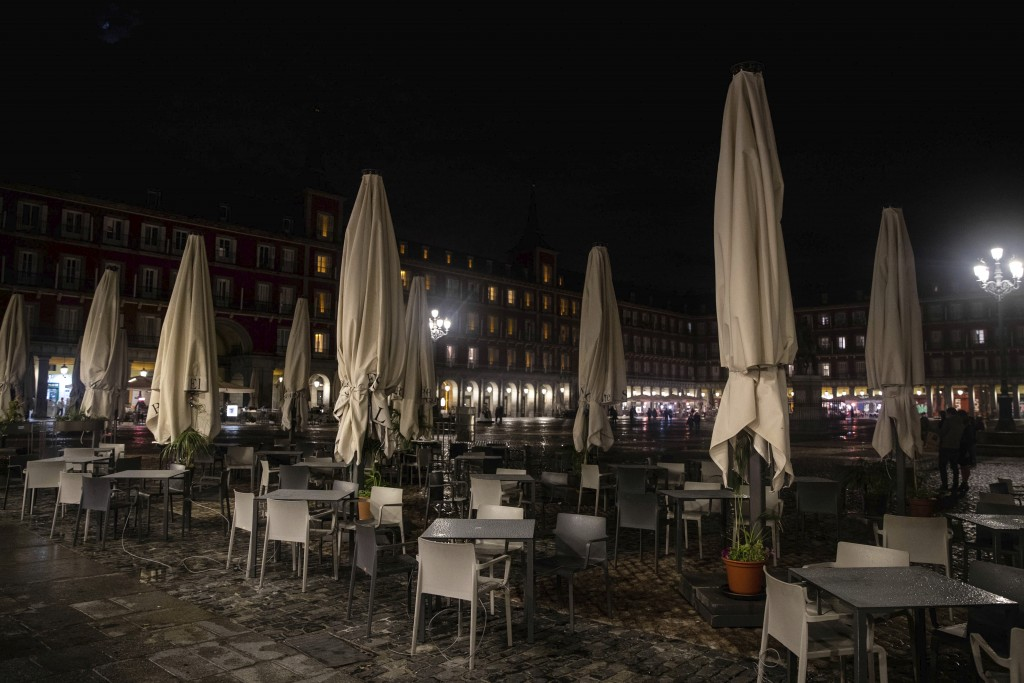 A terrace of a bar is closed in the Mayor square in downtown Madrid, Spain, Friday, Oct. 23, 2020. (AP Photo/Manu Fernandez)