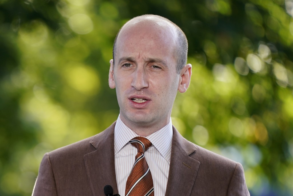 FILE - In this Aug. 20, 2020, file photo President Donald Trump's White House Senior Adviser Stephen Miller speaks during a television interview outsi...