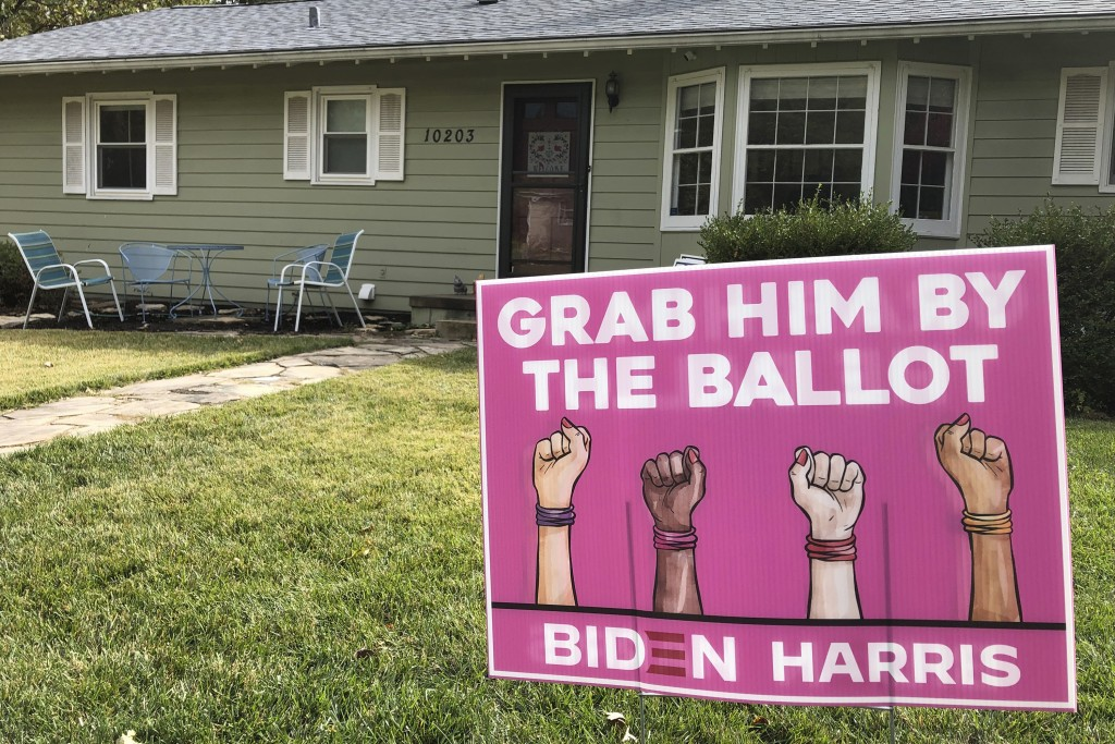A Joe Biden presidential campaign sign greets passersby in a leafy neighborhood of Omaha, Neb., Monday, Oct. 19, 2020. If the election is close, Nebra...