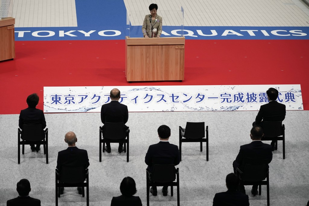 Tokyo Gov. Yuriko Koike, center top, delivers opening remarks during a grand opening ceremony of Tokyo Aquatics Center Saturday, Oct. 24, 2020, in Tok...