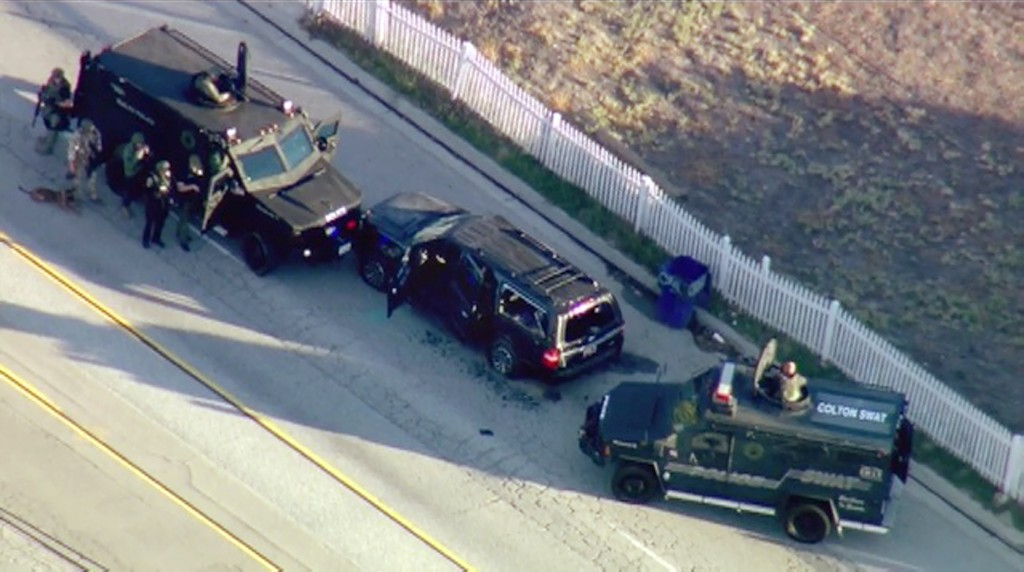 FILE - In this Dec. 2, 2015 file photo from video, armored vehicles surround an SUV following a shootout in San Bernardino, Calif. Enrique Marquez Jr....