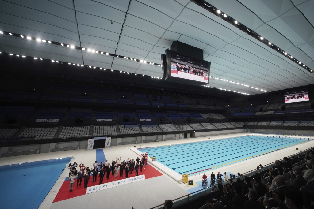 Tokyo Gov. Yuriko Koike and other guests pose for photos during a grand opening ceremony of Tokyo Aquatics Center Saturday, Oct. 24, 2020, in Tokyo. T...