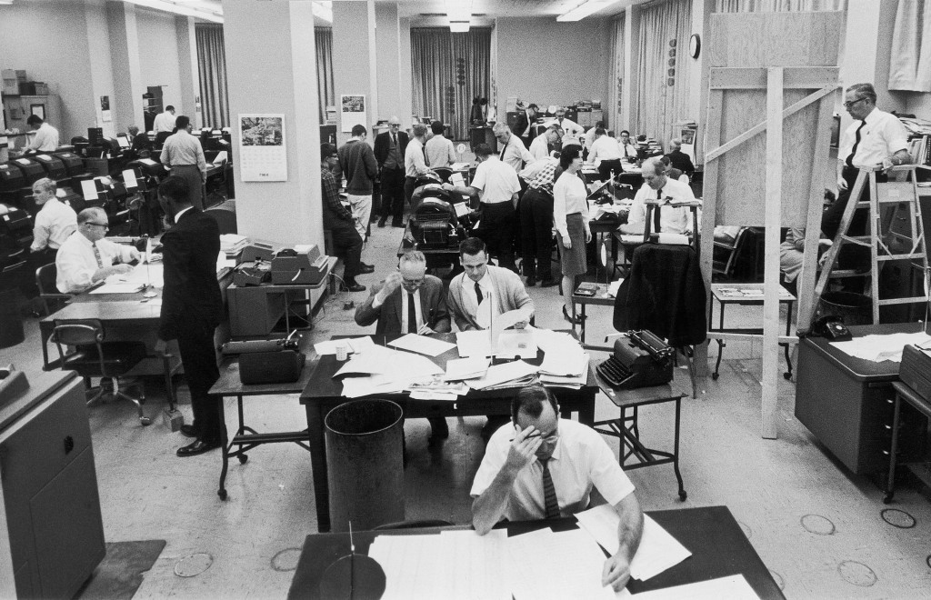 FILE - In this Nov. 3, 1964, file photo, staffers work on election night at the Washington, D.C. bureau of The Associated Press. As it has for more th...