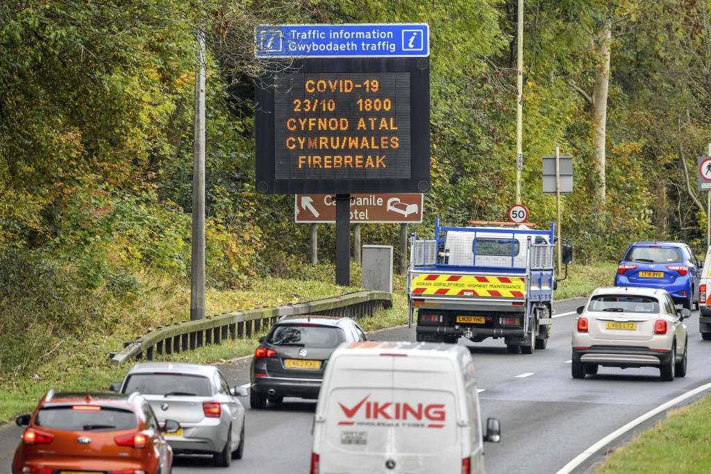 """A matrix sign on the A48(M) heading towards Cardiff informing motorists to Wales entering a """"firebreak"""" lockdown, Friday, Oct. 23, 2020. A police forc..."""
