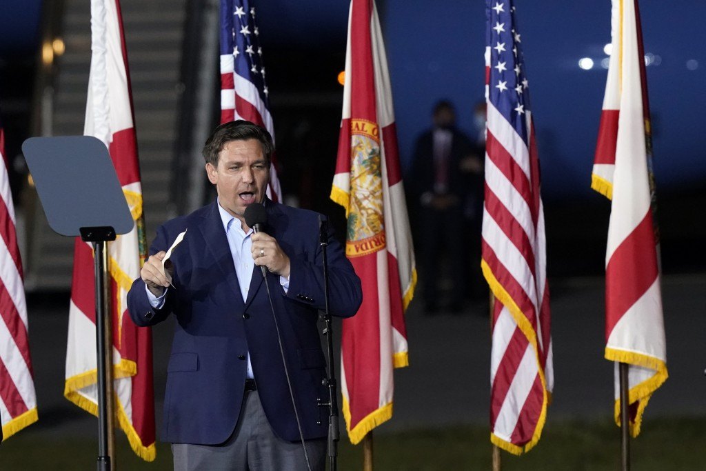 Florida Gov. Ron DeSantis speaks before President Donald Trump at a campaign rally in Pensacola, Fla., Friday, Oct. 23, 2020. (AP Photo/Gerald Herbert...