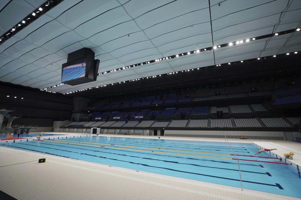 A swimmer demonstrates during a grand opening ceremony of Tokyo Aquatics Center Saturday, Oct. 24, 2020, in Tokyo. The Tokyo 2020 organizing committee...