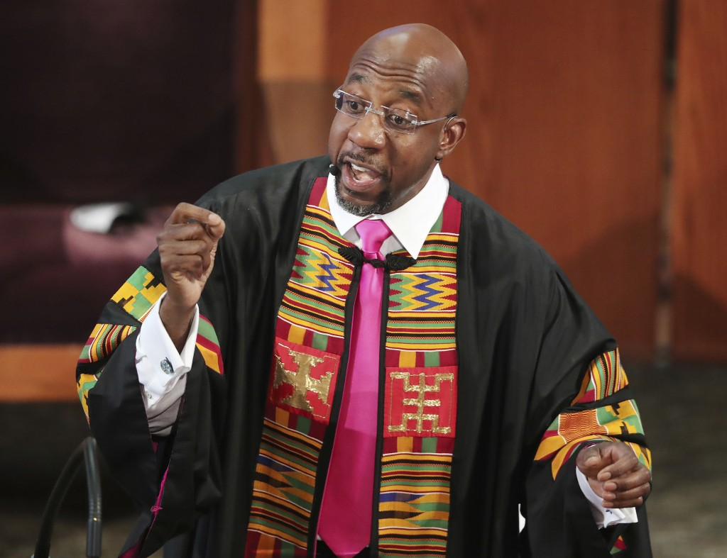 FILE- In this June 23, 2020, file photo, Rev. Raphael G. Warnock delivers the eulogy for Rayshard Brooks' funeral at Ebenezer Baptist Church in Atlant...