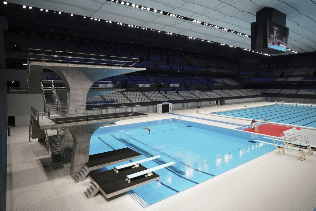 A diver demonstrates during a grand opening ceremony of Tokyo Aquatics Center Saturday, Oct. 24, 2020, in Tokyo. The Tokyo 2020 organizing committee h...
