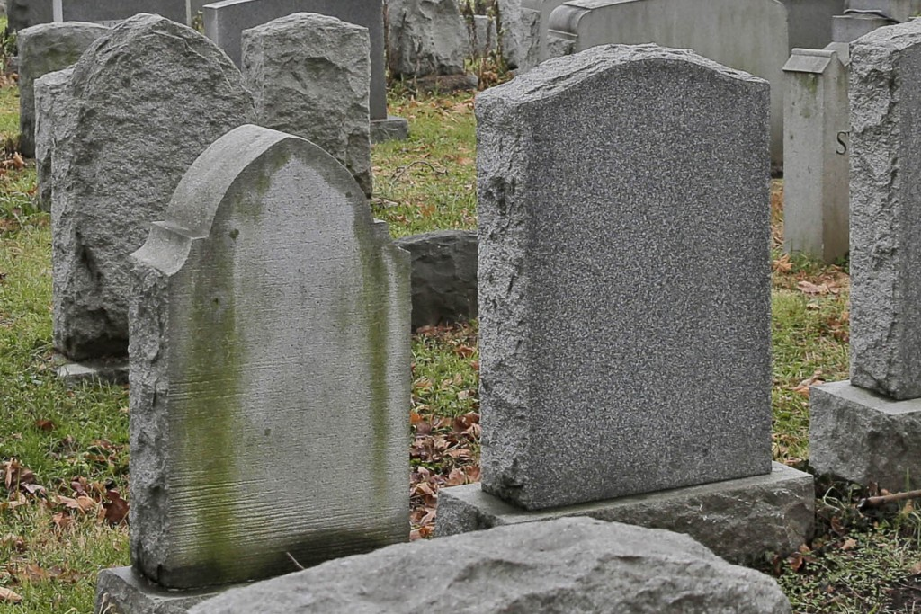 FILE - This Dec. 11, 2019 file photo shows gravestones at a cemetery in New Jersey. The U.S. suicide death rate fell slightly in 2019, the first annua...