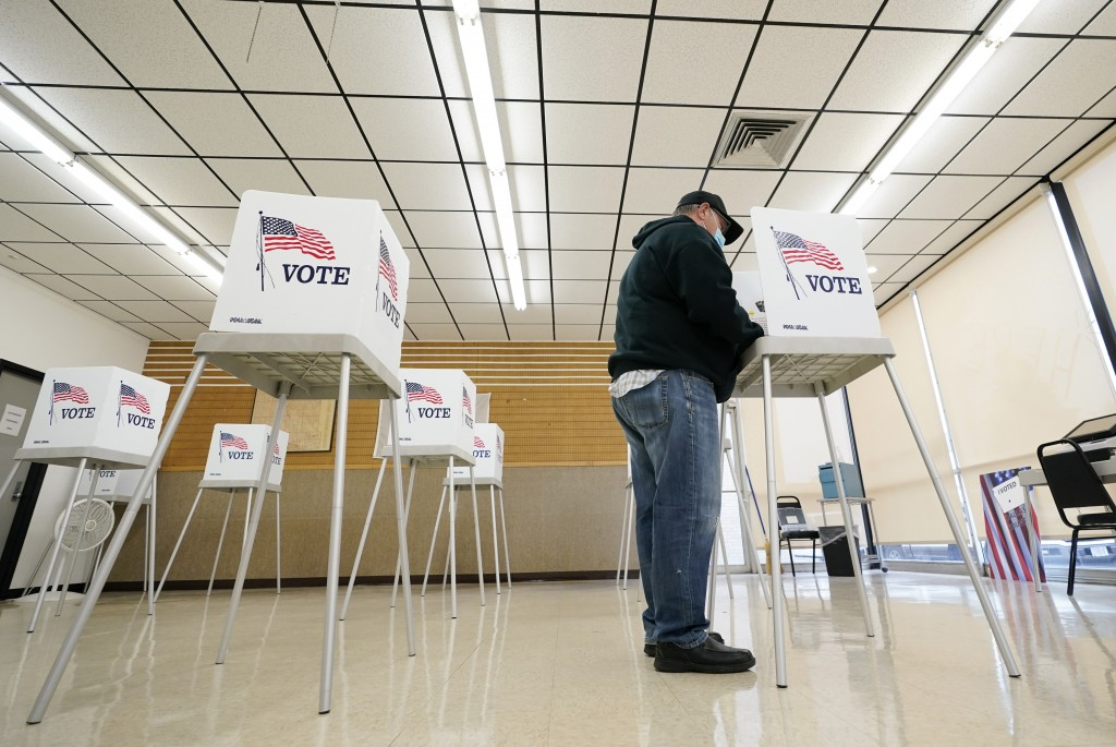 FILE - In this Oct. 20, 2020, file photo, Kelly Wingfield, of Urbandale, Iowa, fills out his ballot during early voting for the general election in Ad...