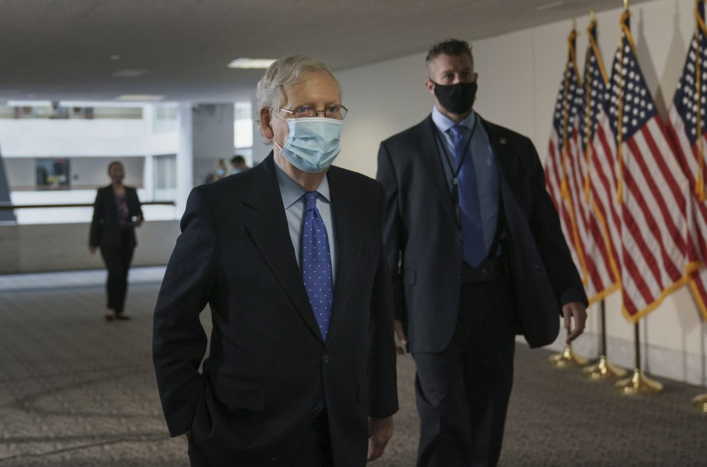 Senate Majority Leader Mitch McConnell, R-Ky., arrives for a closed-door meeting with Senate Republicans, on Capitol Hill in Washington, Friday, Oct. ...