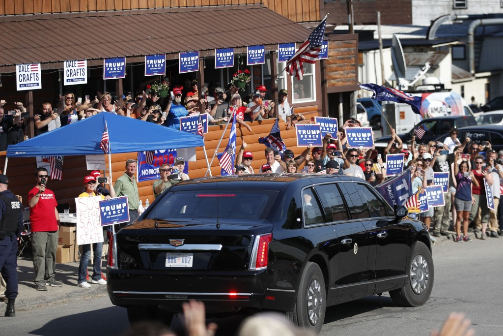FILE - In this June 5, 2020 file photo, supporters of President Donald Trump cheer as the motorcade passes during Trump's visit to Guilford, Maine. Tr...