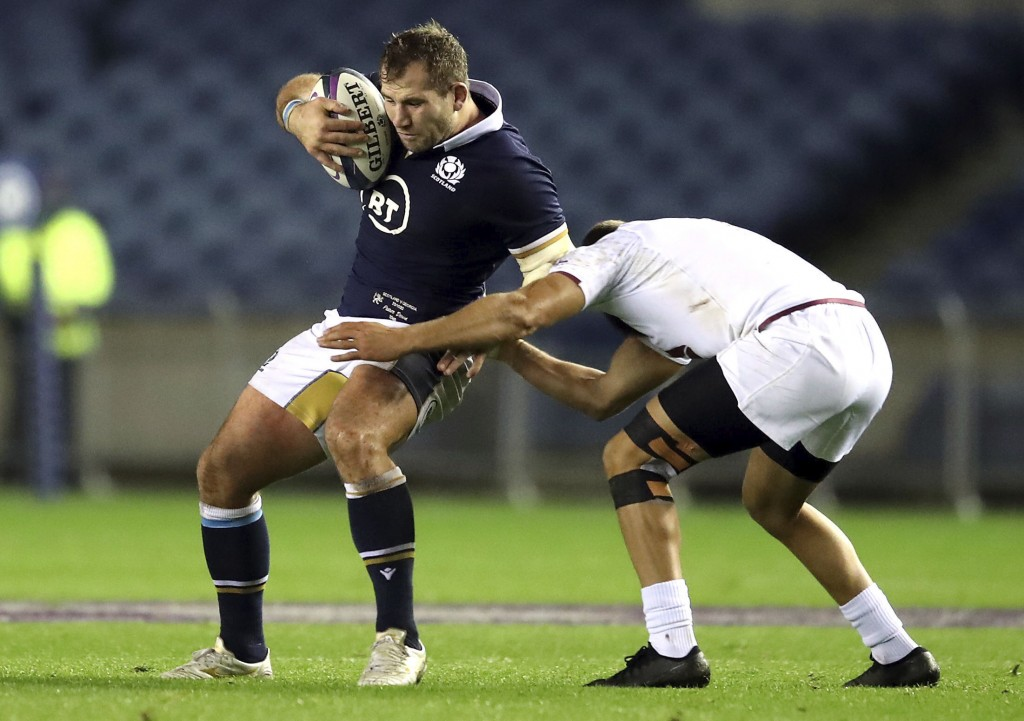 Scotland's Fraser Brown, left, is tackled by Georgia's Merab Sharikadze battle for the ball during the Autumn International rugby match at BT Murrayfi...