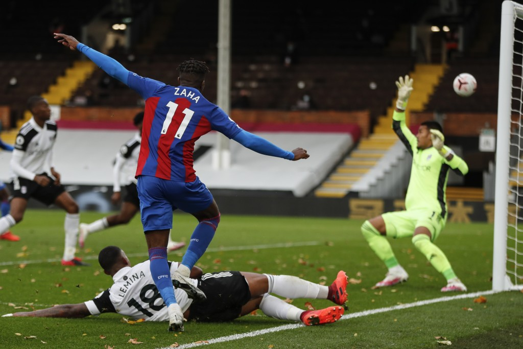 Crystal Palace's Wilfried Zaha shoots at goal during the English Premier League soccer match between Fulham and Crystal Palace at Craven Cottage in lo...