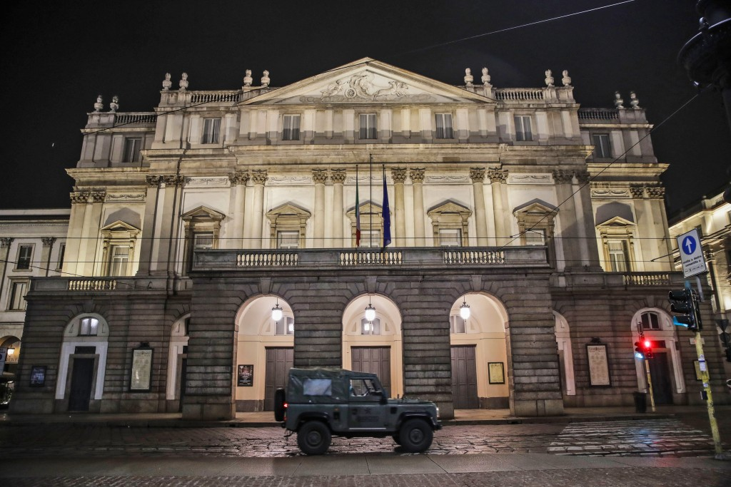 A military vehicle drives past La Scala opera theater in Milan, northern Italy, early Sunday, Oct. 25, 2020. Since the 11 p.m.-5 a.m. curfew took effe...