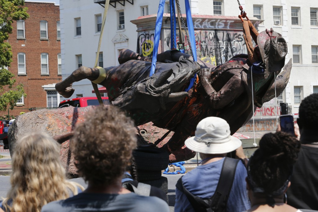 FILE - This Tuesday July 7, 2020, file photo shows crews at they lower the statue Confederate General J.E.B. Stuart in preparation for transport after...