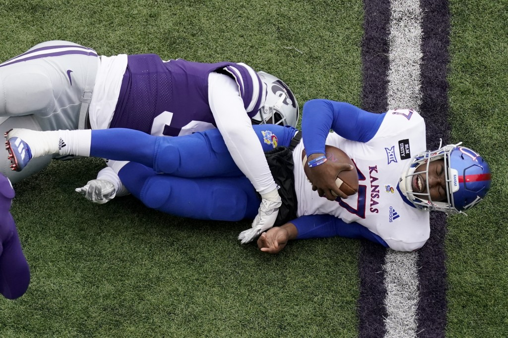 Kansas quarterback Jalon Daniels (17) is sacked by Kansas State defensive end Felix Anudike (91) during the second half of an NCAA football game Satur...