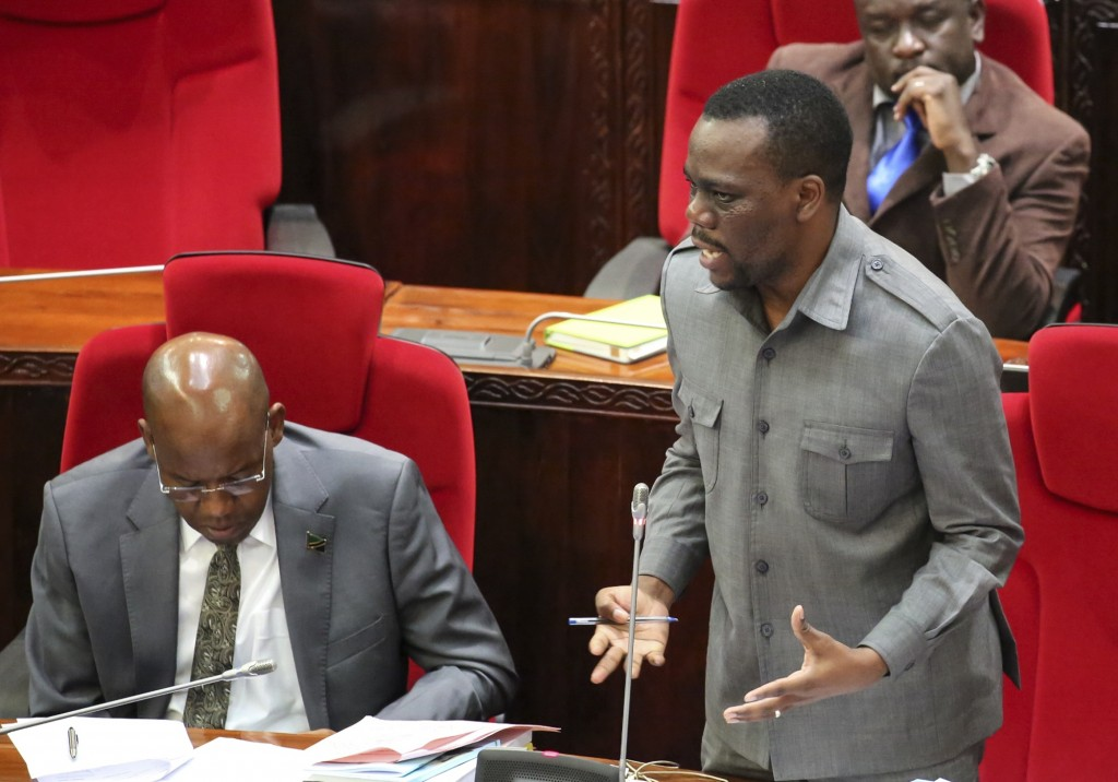 FILE - In this Friday, May 5, 2017 file photo, Tanzanian opposition politician Zitto Kabwe, right, speaks at the national assembly in Dodoma, Tanzania...