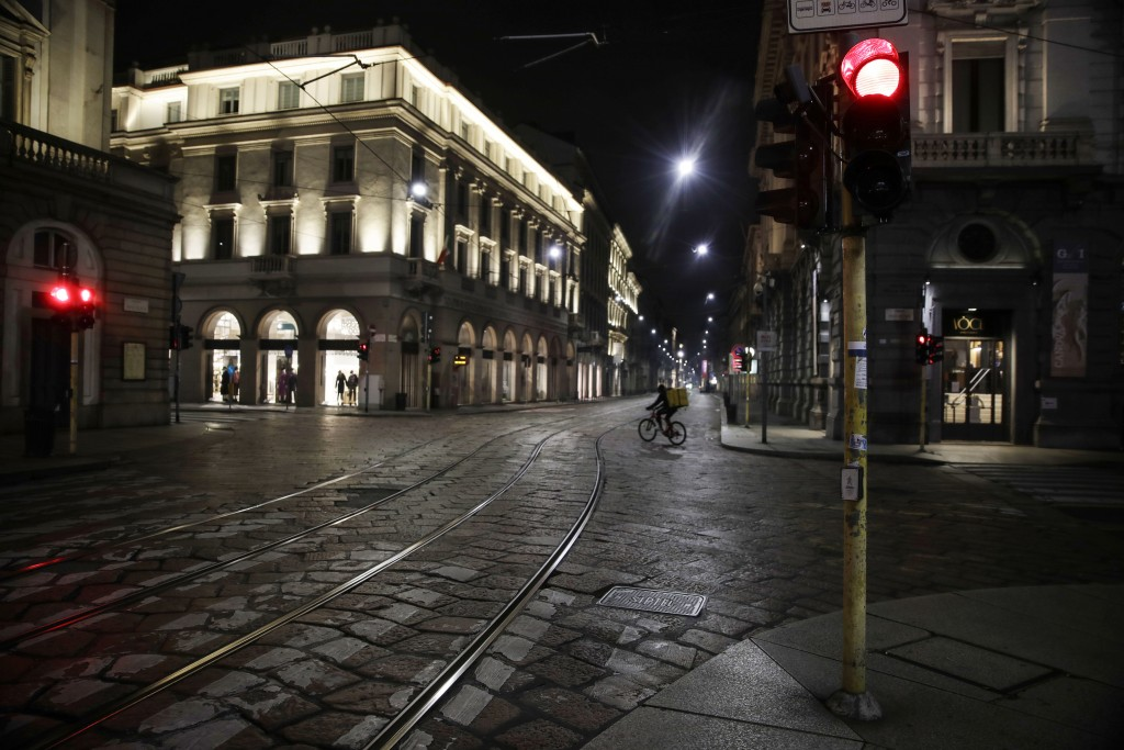 Streets are empty in Milan, northern Italy, early Sunday, Oct. 25, 2020. Since the 11 p.m.-5 a.m. curfew took effect last Thursday, people can only mo...