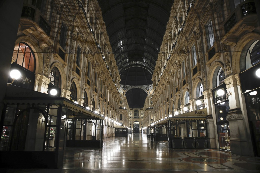 The Vittorio Emanuele II arcarde is deserted, in Milan, northern Italy, early Sunday, Oct. 25, 2020. Since the 11 p.m.-5 a.m. curfew took effect last ...