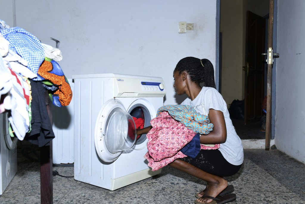 In this photo taken on Wednesday, Oct. 14, 2020, Dodeye Ewa, 16 year does her laundry at her parents house in Calabar, Nigeria. The third child is bot...
