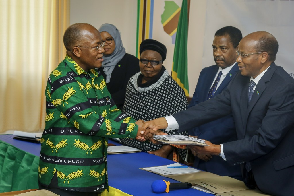 FILE - In this Tuesday, Aug. 25, 2020 file photo, President John Magufuli, left, who seeks a second five-year term, hands over his electoral nominatio...