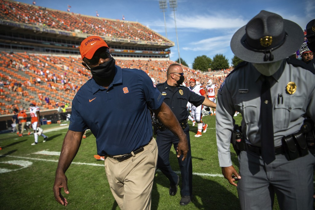 Syracuse head coach Dino Babers walks off the field after an NCAA college football game against Clemson in Clemson, S.C., on Saturday, Oct. 24, 2020. ...