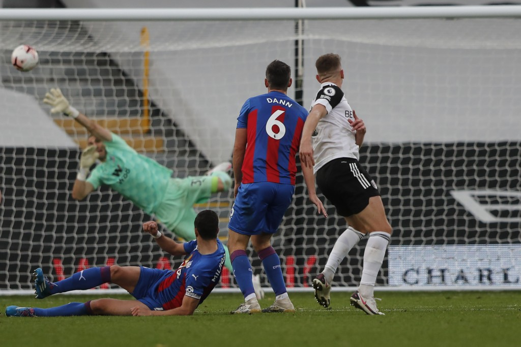 Fulham's Tom Cairney, right, scores a goal during the English Premier League soccer match between Fulham and Crystal Palace at Craven Cottage in Londo...